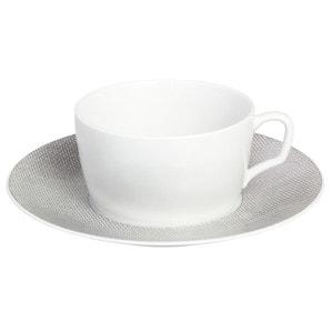 Чашка капучино с блюдцем